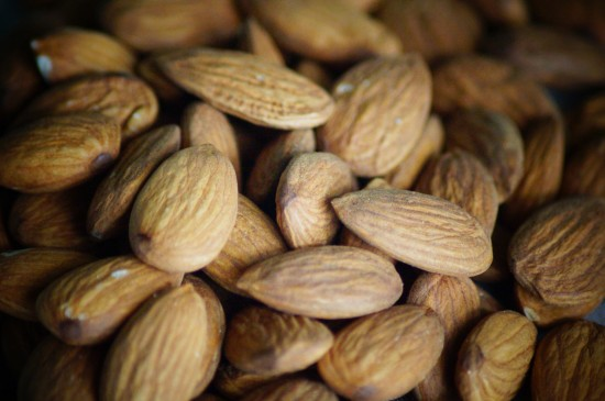 Health benefits of almonds include heart health, bone building and stress reduction.